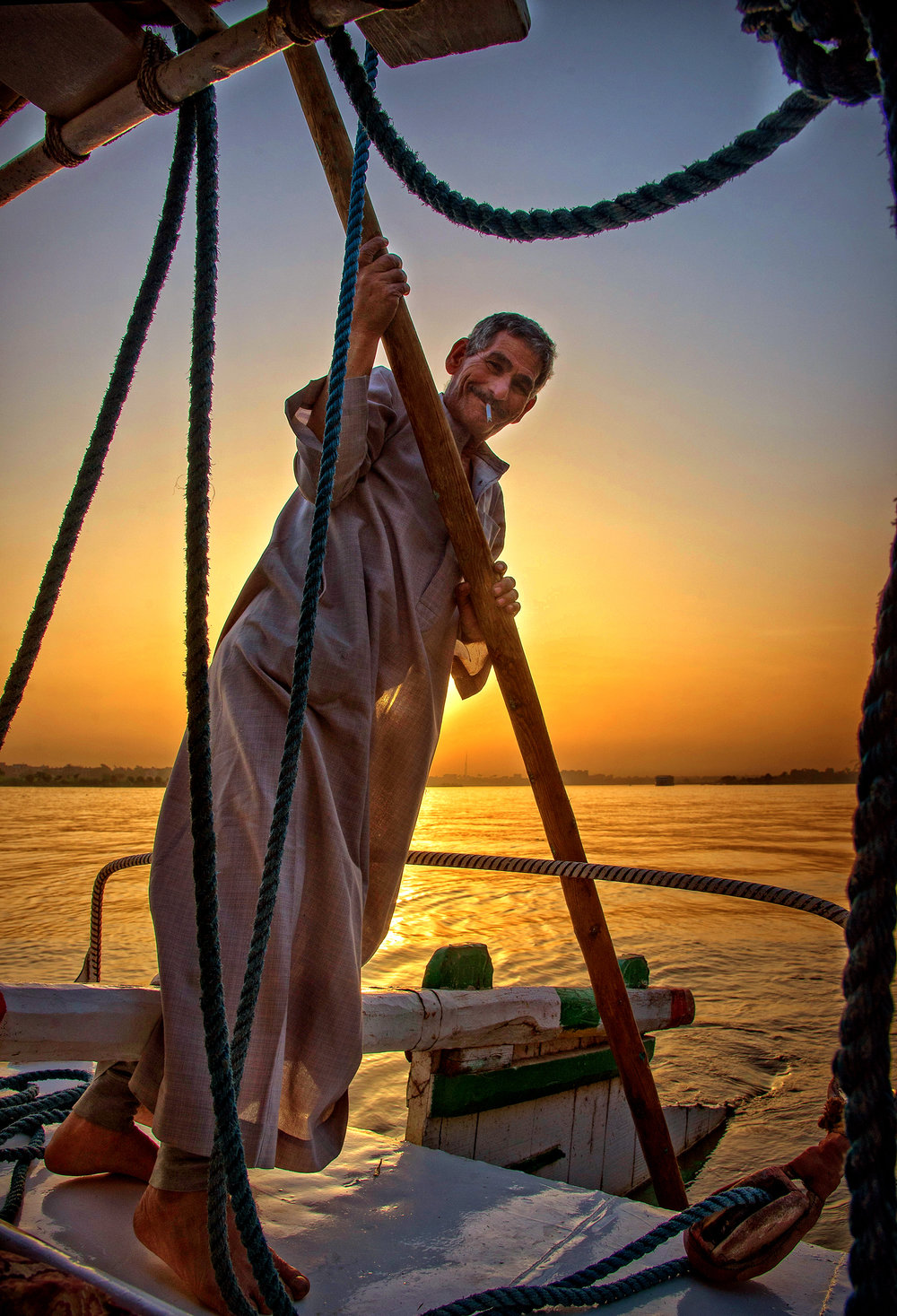 Ahoy! The captain of a felucca on the Nile River