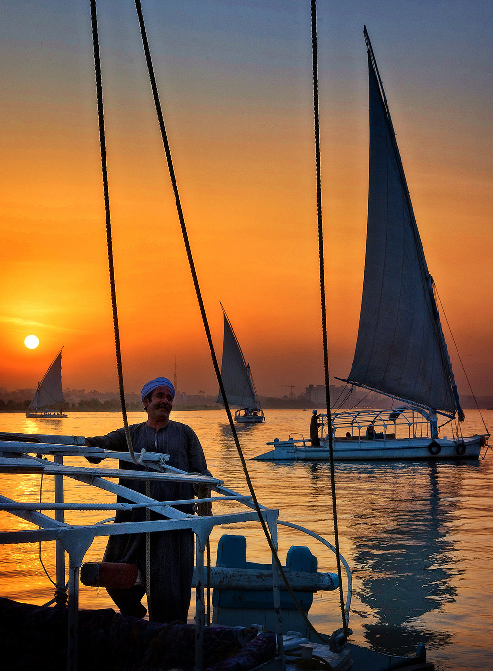 Take a felucca sailboat ride to see the grandeur of the Nile