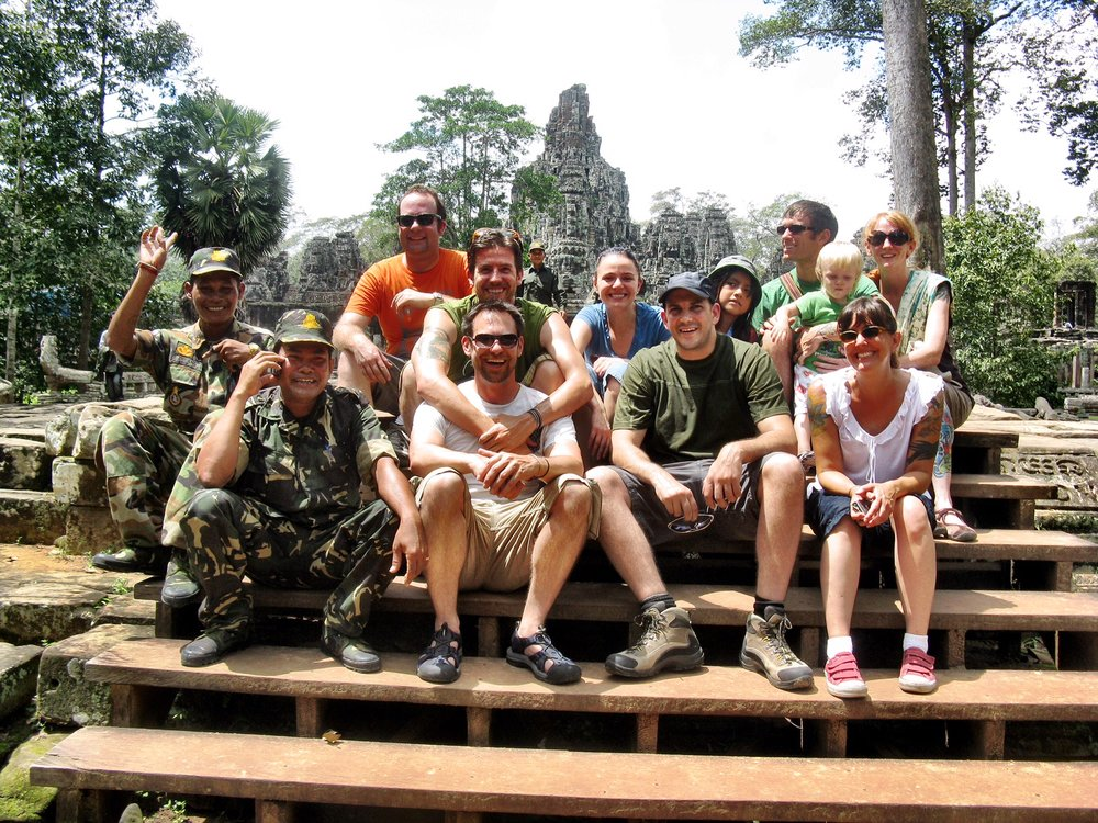 A couple of officers decided to join our group photo at Bayon in Cambodia