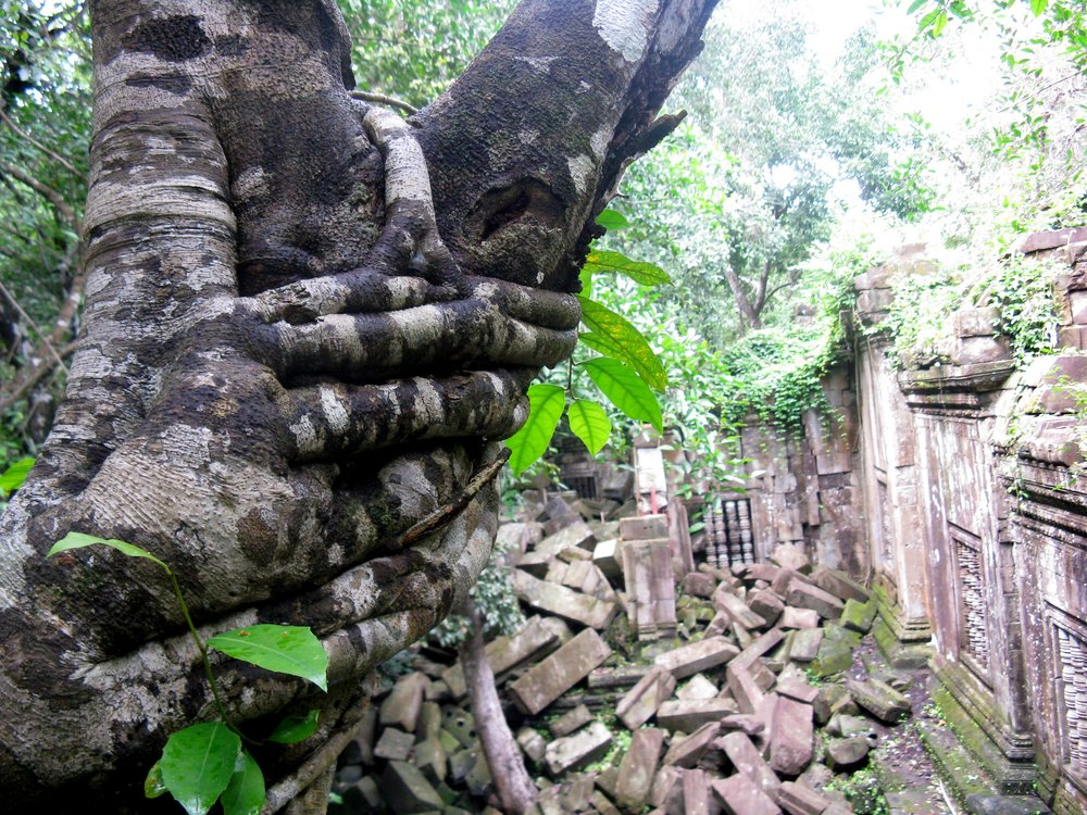 Piles of stone rubble that have tumbled down from Beng Mealea's upper walls lie haphazardly throughout the site