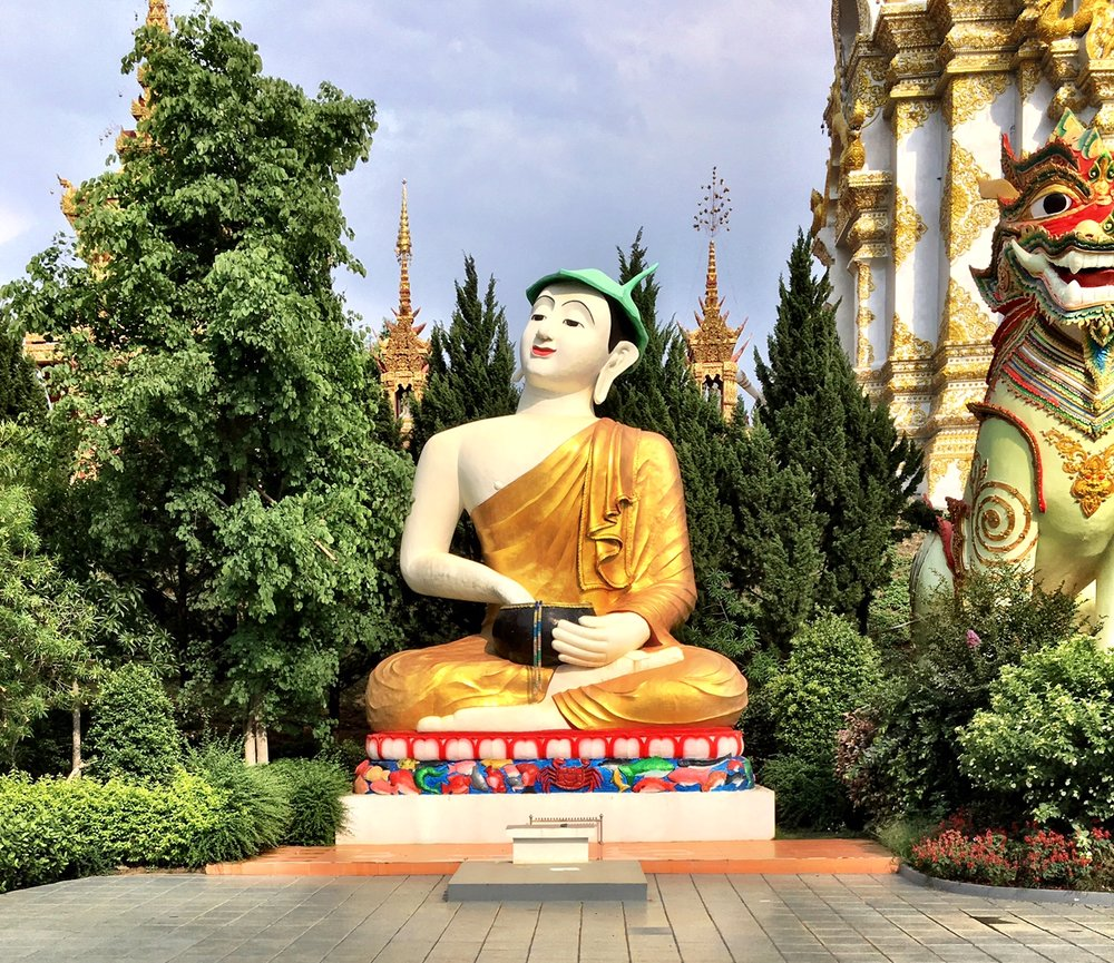 With his lotus cap, alms bowl and upturned smiling face, there's just something Duke found so appealing about Phra Upakut, seen here at Wat Sang Kaew