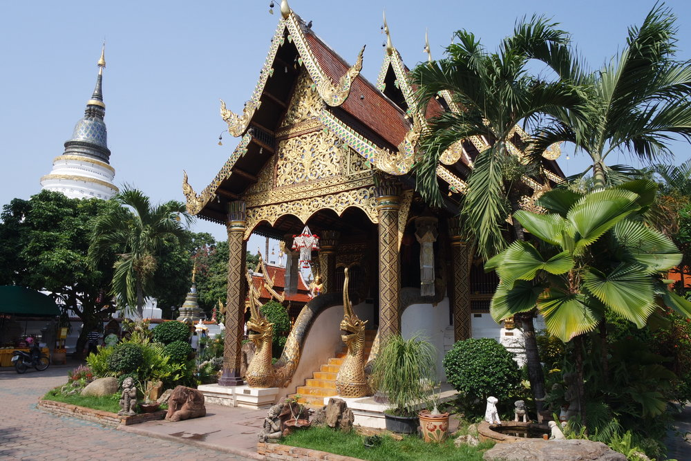 Thai temples, like Wat Ket Karam in Chiang Mai, have worship halls (viharns), towers containing relics (chedis) and a mix of other buildings