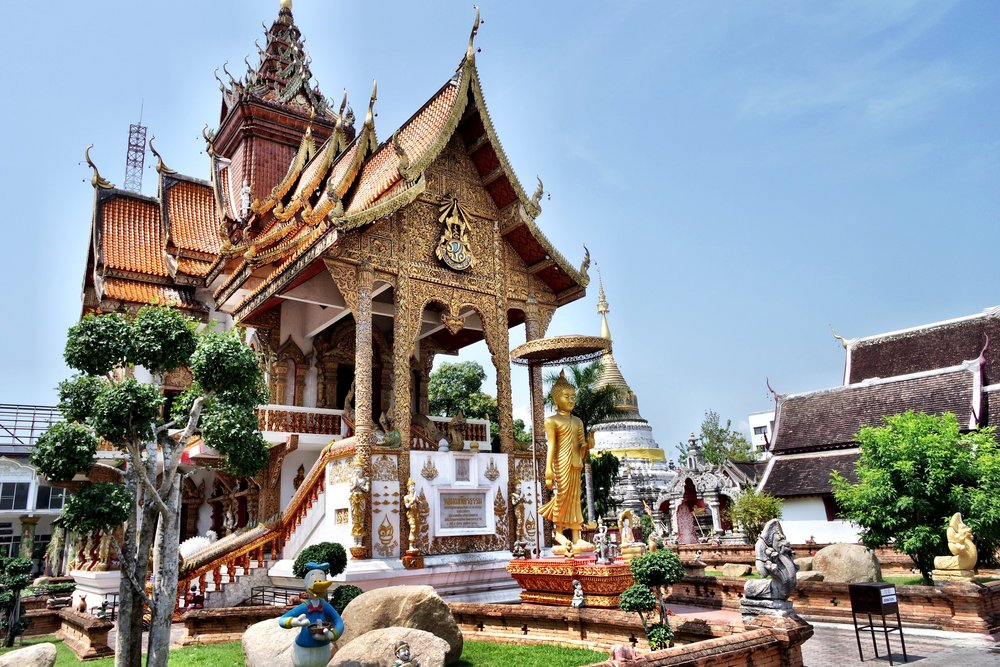 The gorgeous Dhamma Hall exterior is a highlight of Wat Bupphram in Chiang Mai, Thailand. Can you spot Donald Duck eating a bowl of noodles out front?