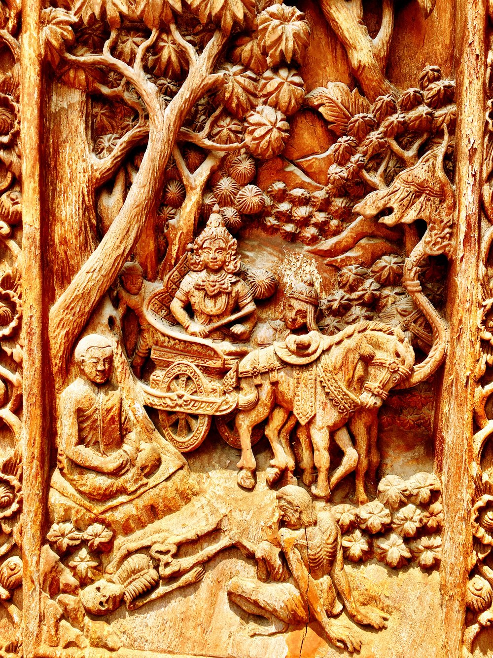 A detail from the elaborately carved viharn doors