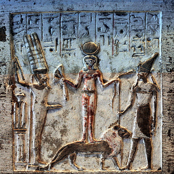 That's Resheph off to the right, the personification of plague. He's hanging out with his friends Min (the fertility god with the big boner) and Qetesh (the goddess of fertility and sexual ecstacy)