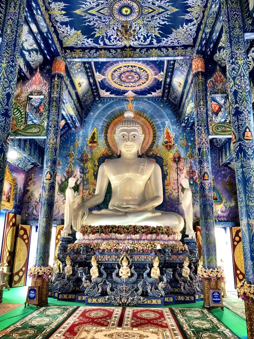 You can take pictures inside the Blue Temple — unlike in the White Temple
