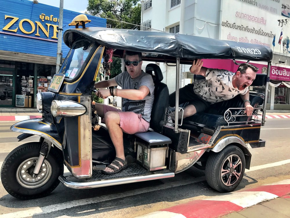 The only good part of getting scammed is that we got some funny pics of Wally driving a tuk-tuk — much to Duke's dismay