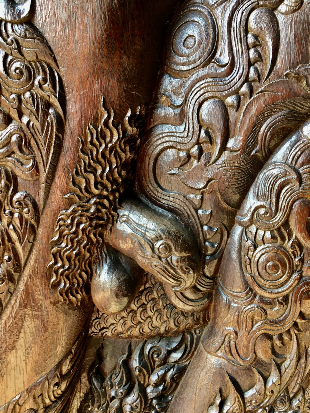 The doors to the main building have intricate carvings of demons with animal-headed penises like the eagle seen here