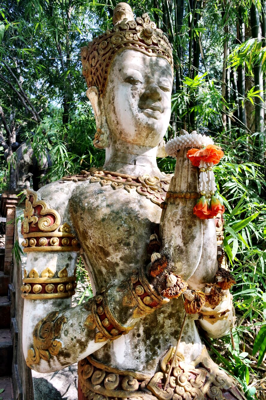 Old statues are found throughout the grounds of Wat Palad