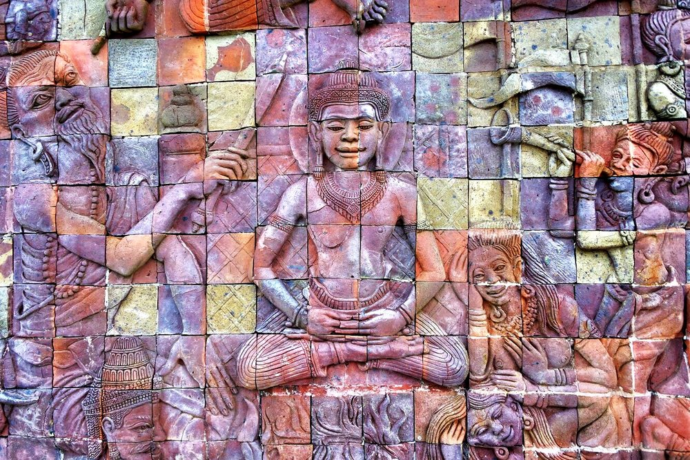 The multicolored stonework bas reliefs outside the King Pagoda tell the story of the Buddha