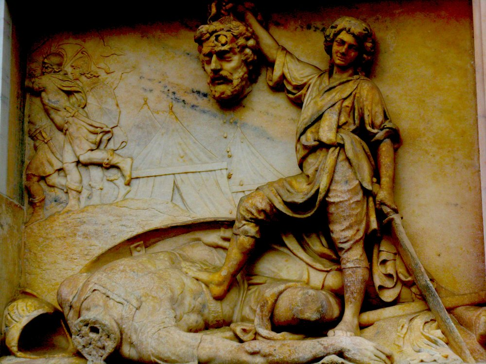 A carving of David slaying the giant Goliath. Somebody send that boy to juvie!