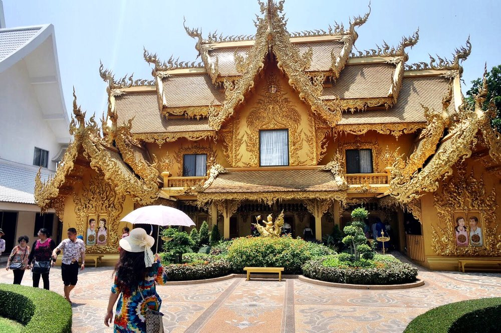 The bathrooms at Wat Rong Khun are housed in this glorious golden building
