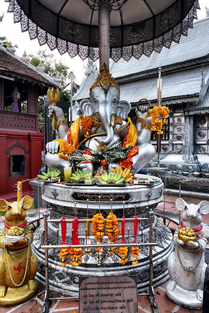 A shrine to the elephant-headed deity Ganesh with his mouse buddies Kroncha offering him his favorite treat, modak, a dumpling filled with freshly grated coconut and palm sugar