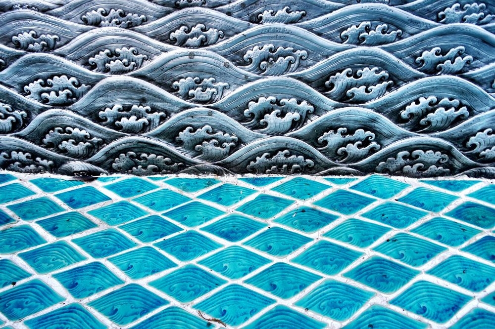 The temple is a dichotomy of pressed silver and turquouise tile