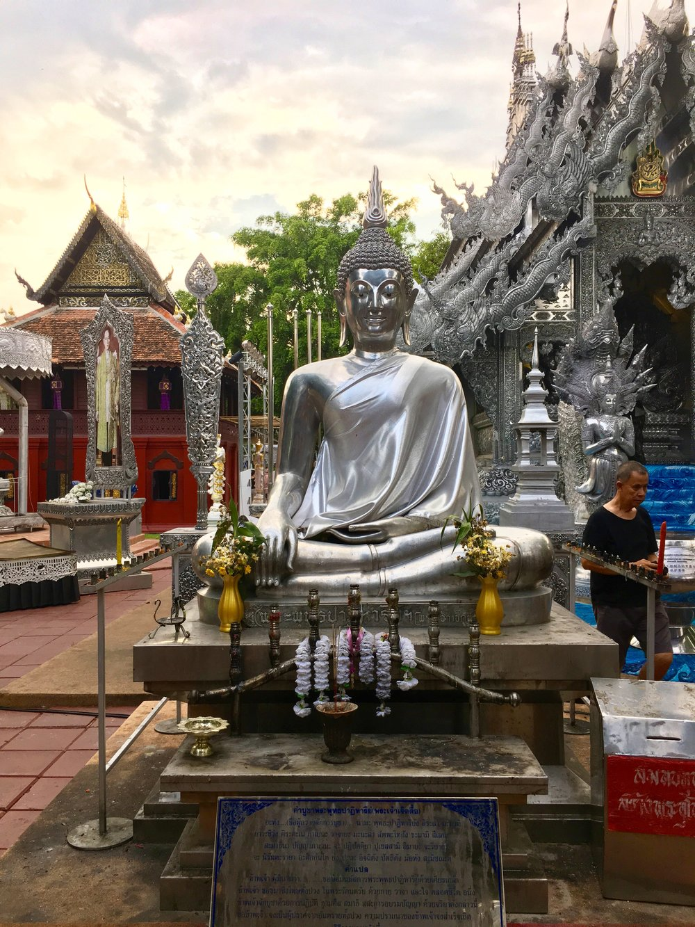 A Buddha with bat-like ears, evidence of the influence of Laotian art, seated outside the ubosot entrance