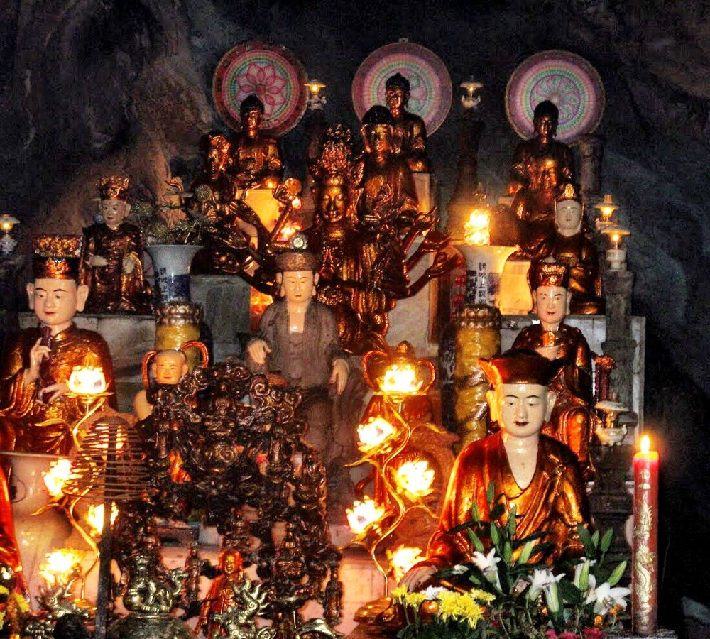 A candlelit shrine in the cave at Perfume Pagoda