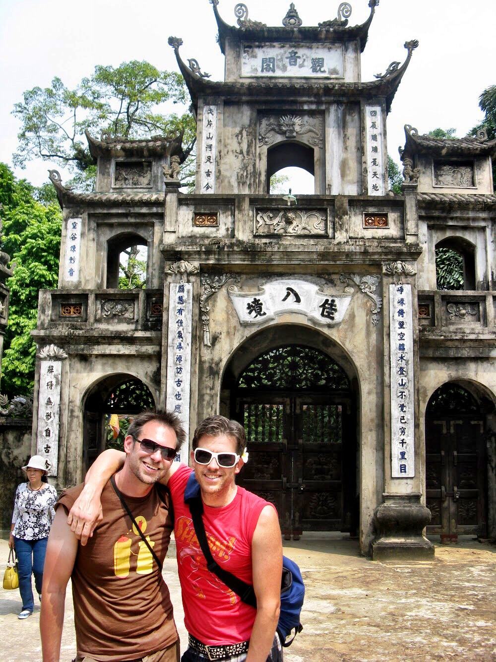 "Duke and Wally in front of a gate at the temple complex, a large portion of which was referred to as ""the Kitchen"" by our guide. We wondered if that meant it was a ceremonial or banquet space"