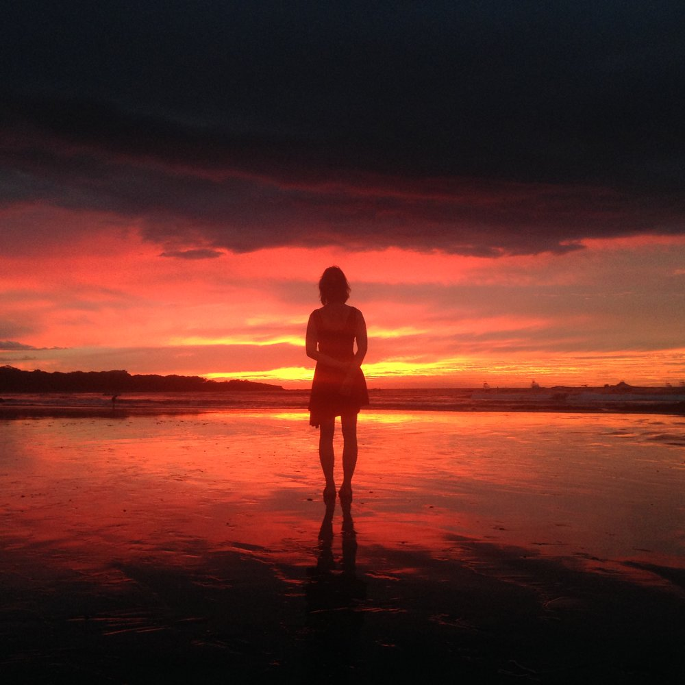 The sunsets in Costa Rica are some of the most amazing you'll ever experience. Here's Allison on the beach at Tamarindo during one of those breathtaking Costa Rican sunsets