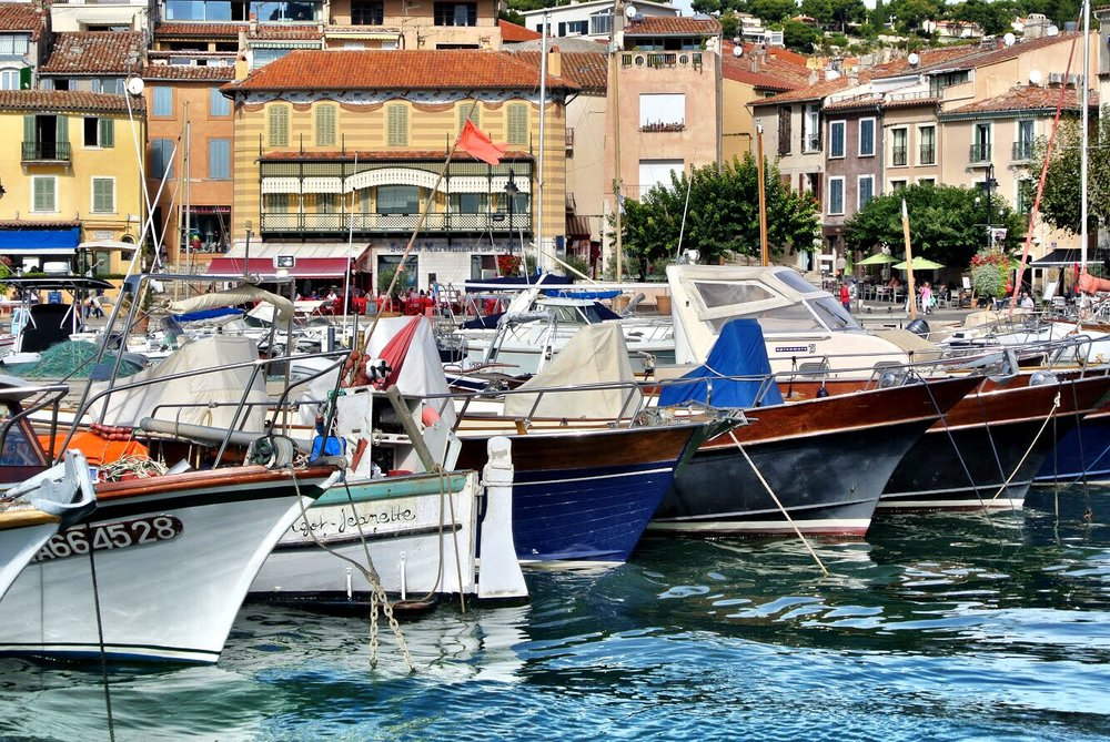Watch the boats come and go in the harbor as you wander this adorable ville