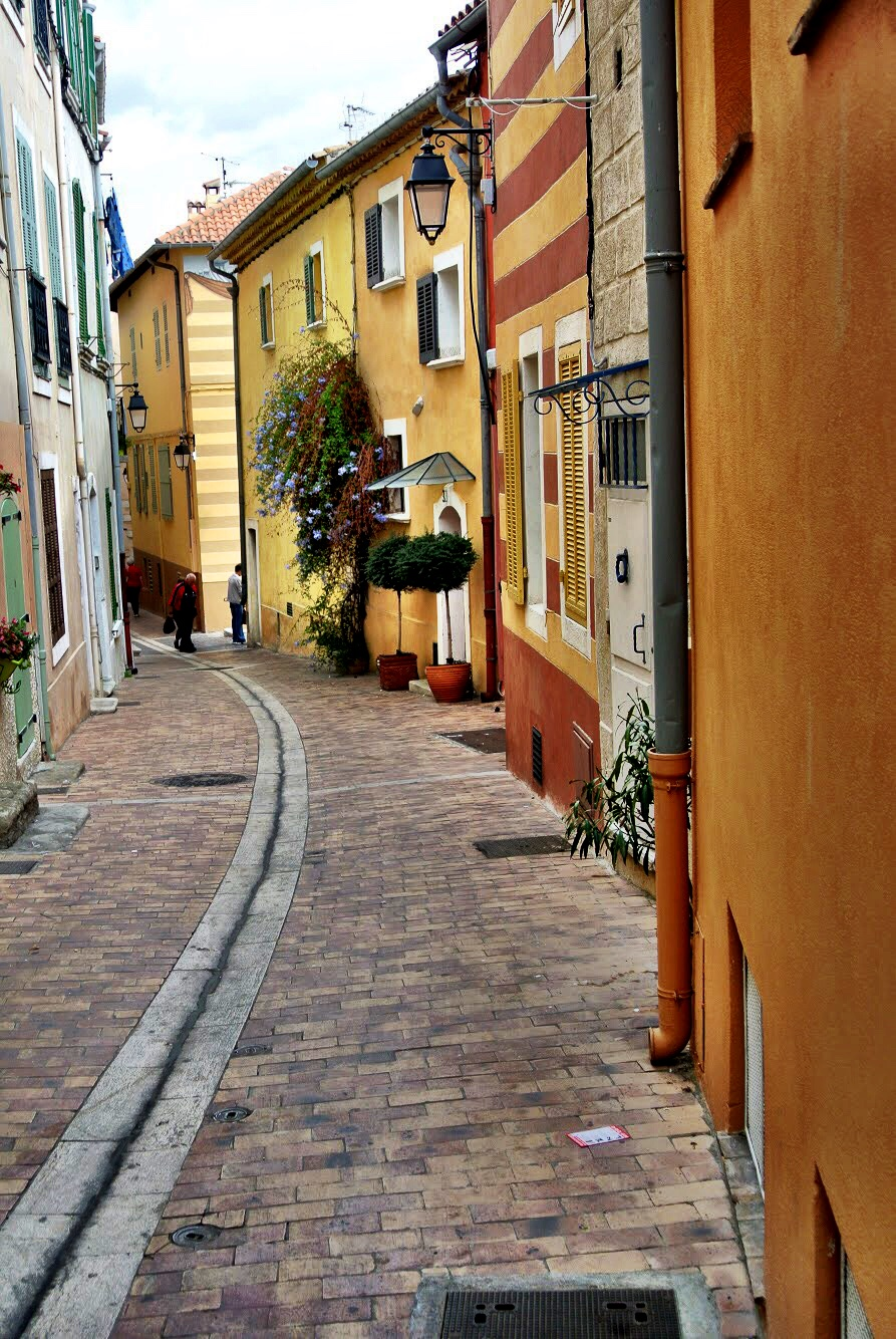 The streets are narrow, rounded and lined with brightly colored buildings — some of which are striped!