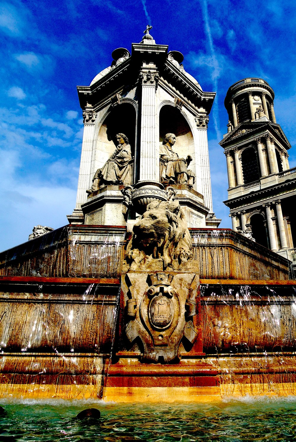 The impressive fountain in front of Saint-Sulpice, with one of its mismatched towers in the background
