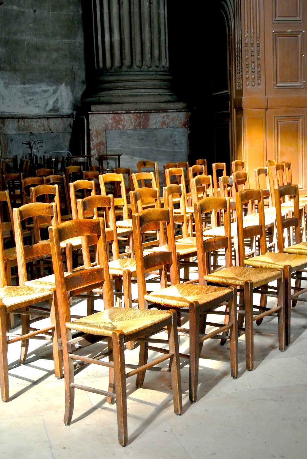 …just row after row of small wooden chairs