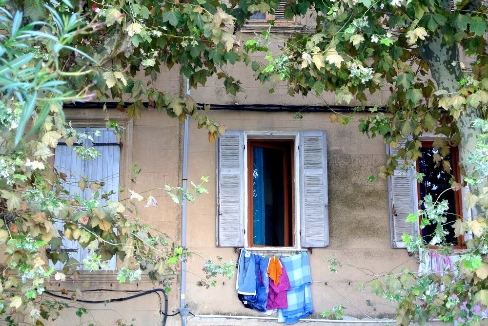 Windows with laundry hanging outside are another common sight in Provence