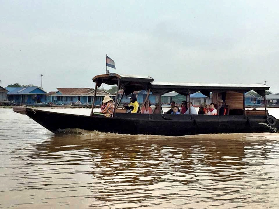 There's no floating village — just a row of houseboats in the distance