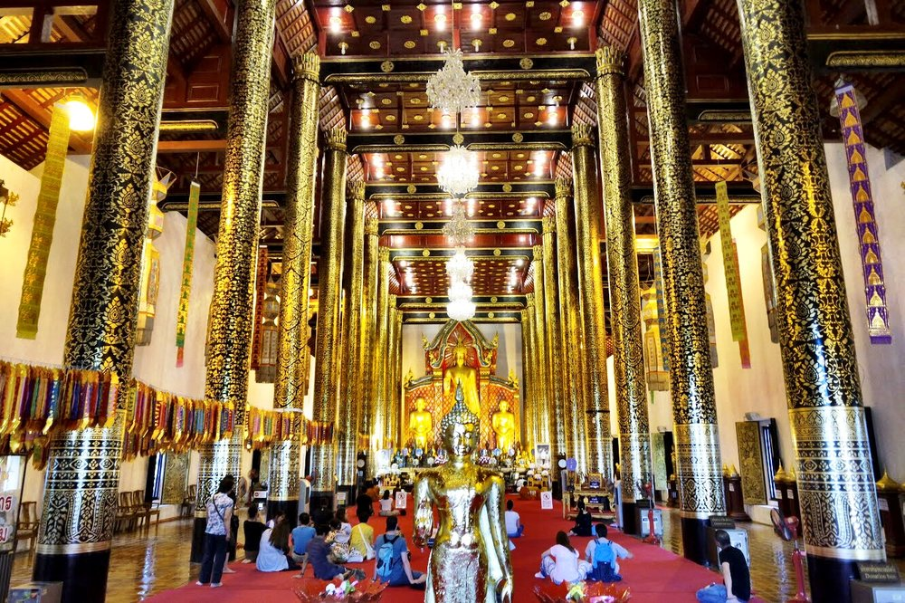 The immense viharn at Chedi Luang is lined with gorgeous gilded pillars
