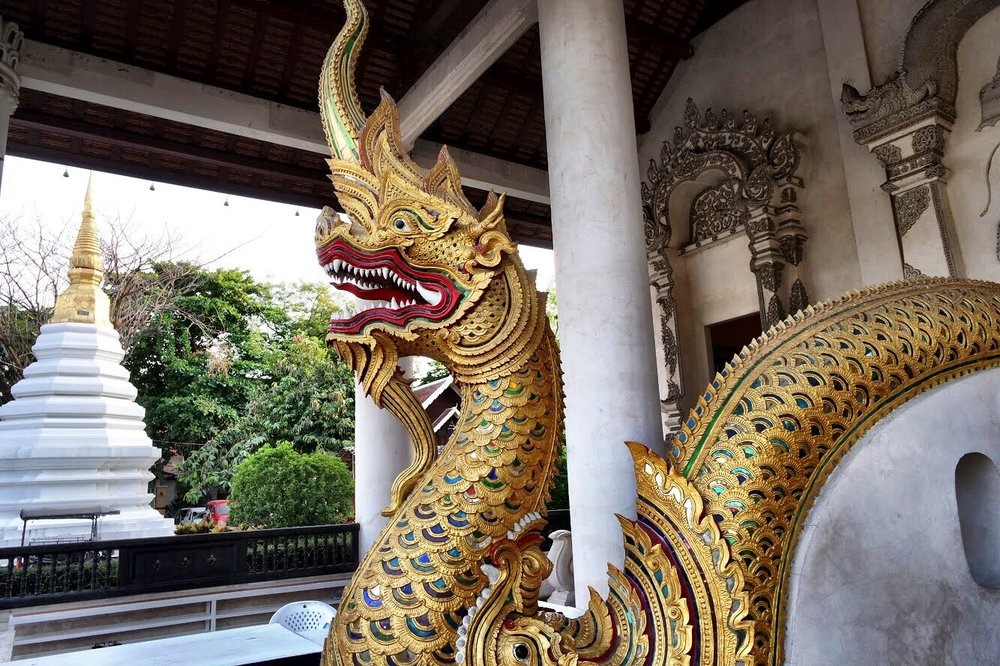 Giant dragon snakes called naga guard the entrance to many Thai temples