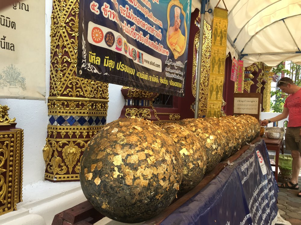 These balls, known as luk nimit, are usually buried under an image of the Buddha