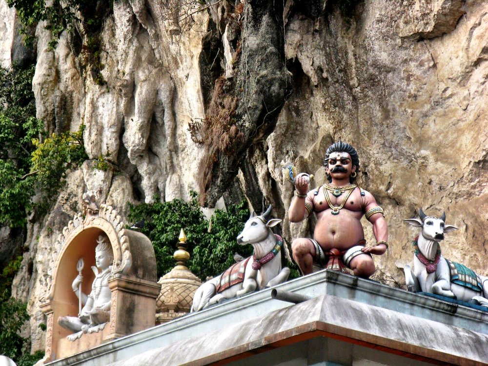 Hindu shrines are built into the limestone cliffs