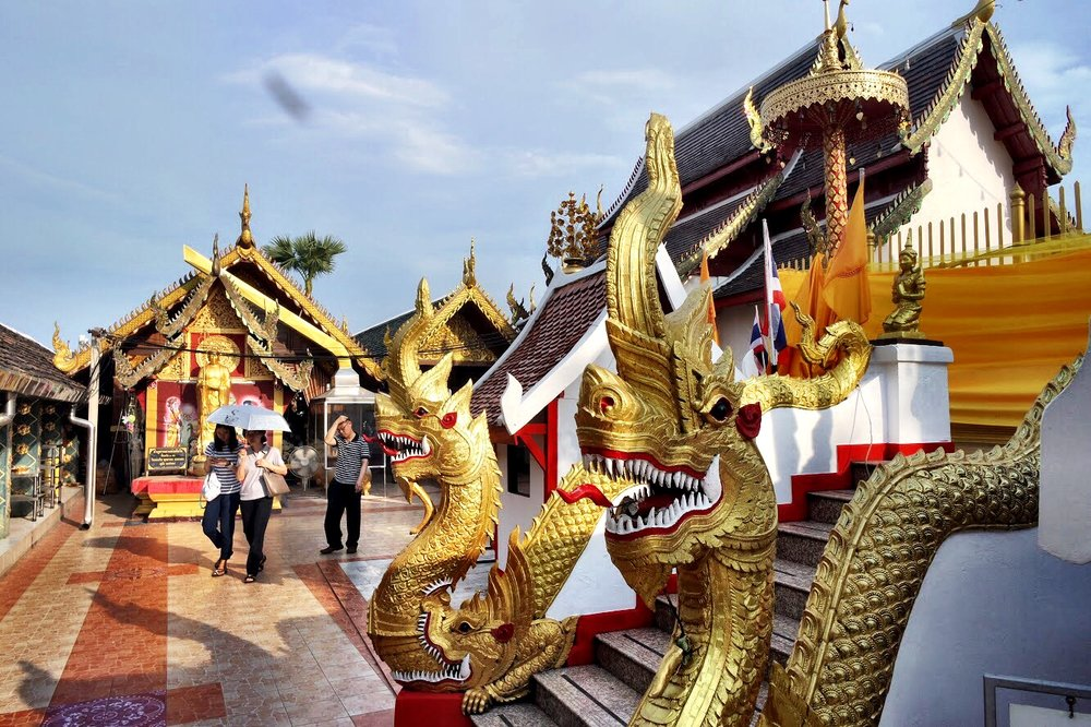 Gold, red and white dominate the temple, which is filled with typical Thai flourishes