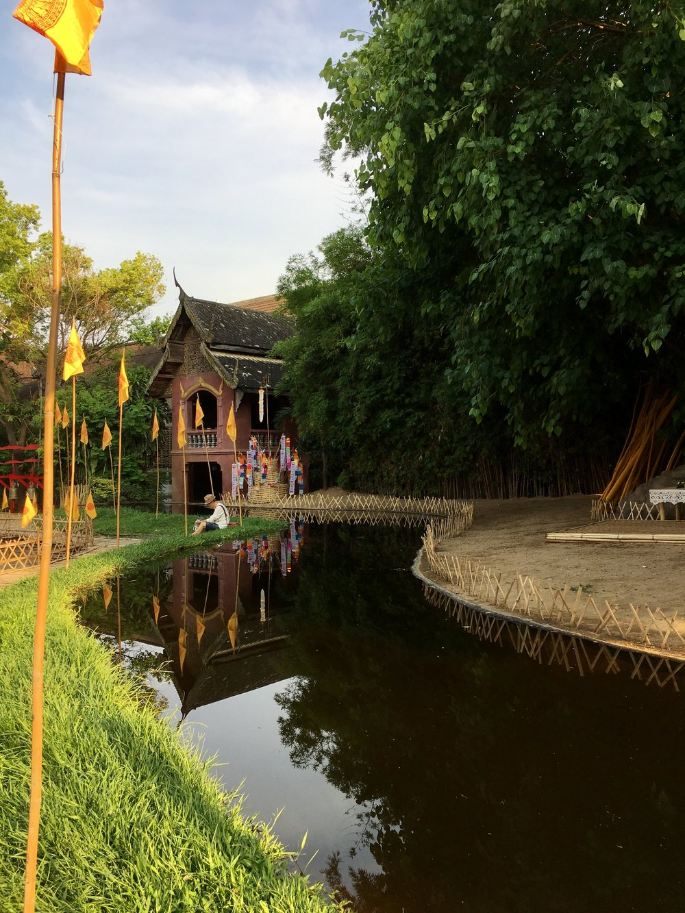 End your adventure exploring Wat Phra Singh with a stroll down the bizarre bamboo walkway