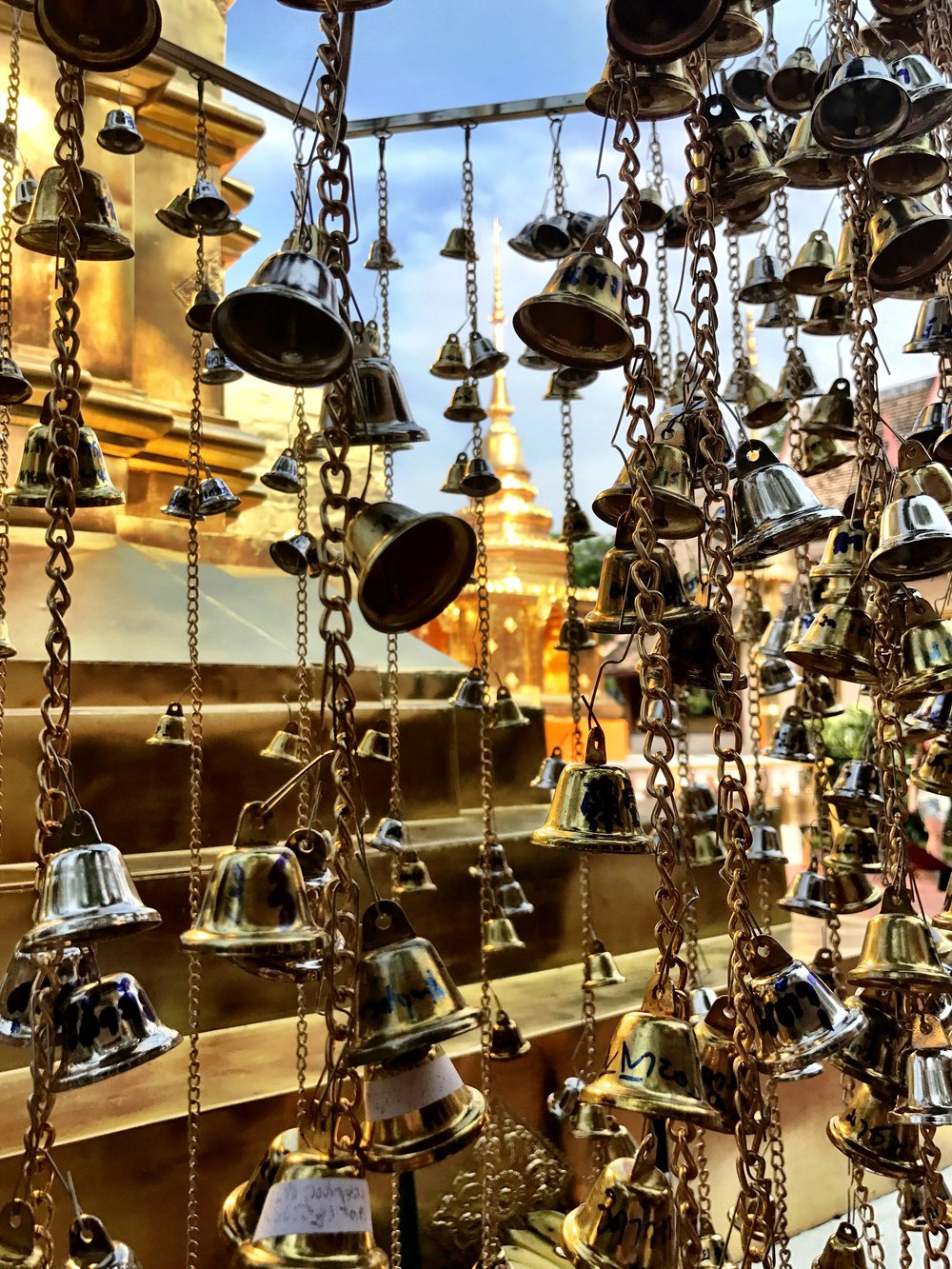 Strands of bells hang behind the chedi