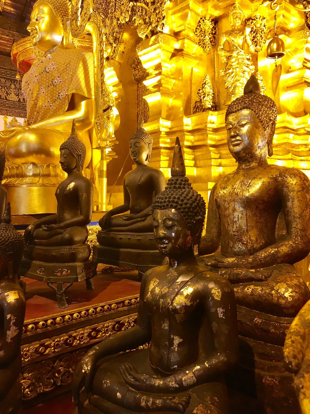 It's not unusual for viharns to have multiple statues of the Buddha