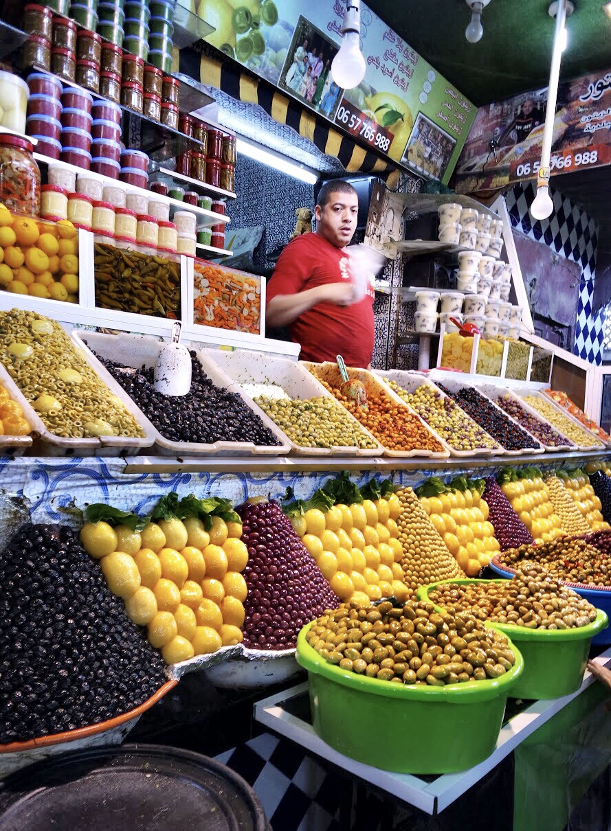The market displays, like those of this fruit and veggie vendor, are works of art and riots of color