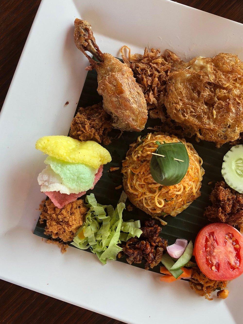 Nasi goreng magelangan combines rice and noodles