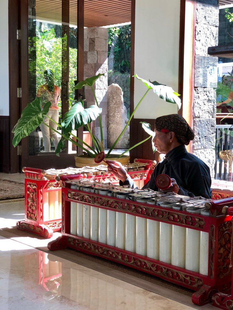 A gamelan musician played soothing tunes in the lobby