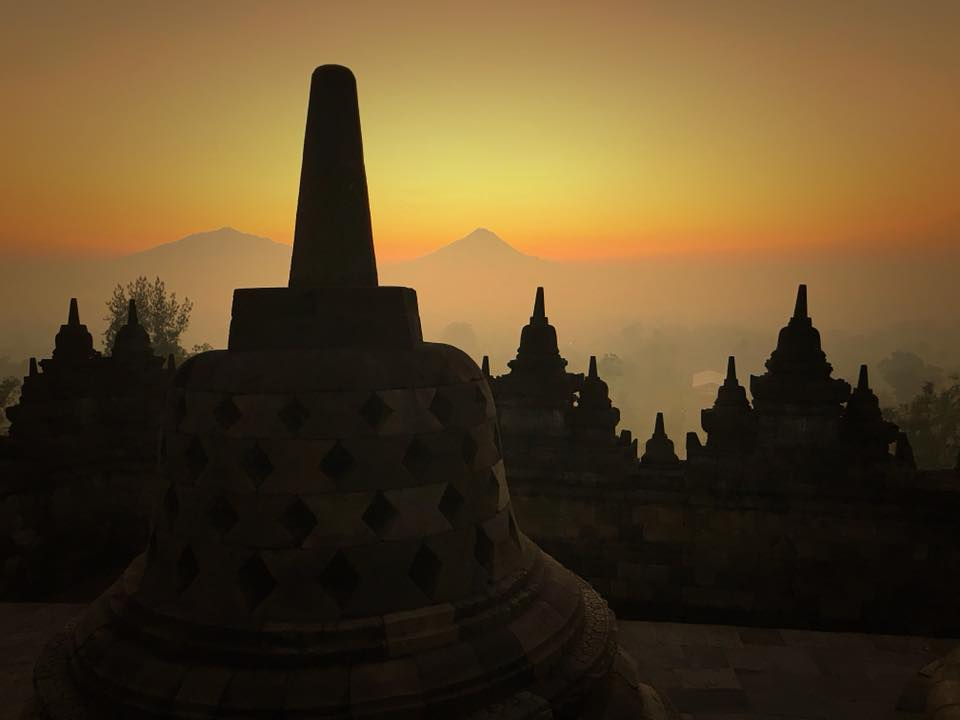 Book a sunrise tour at Borobudur to see the silhouettes of the stupas materialize from the morning mist