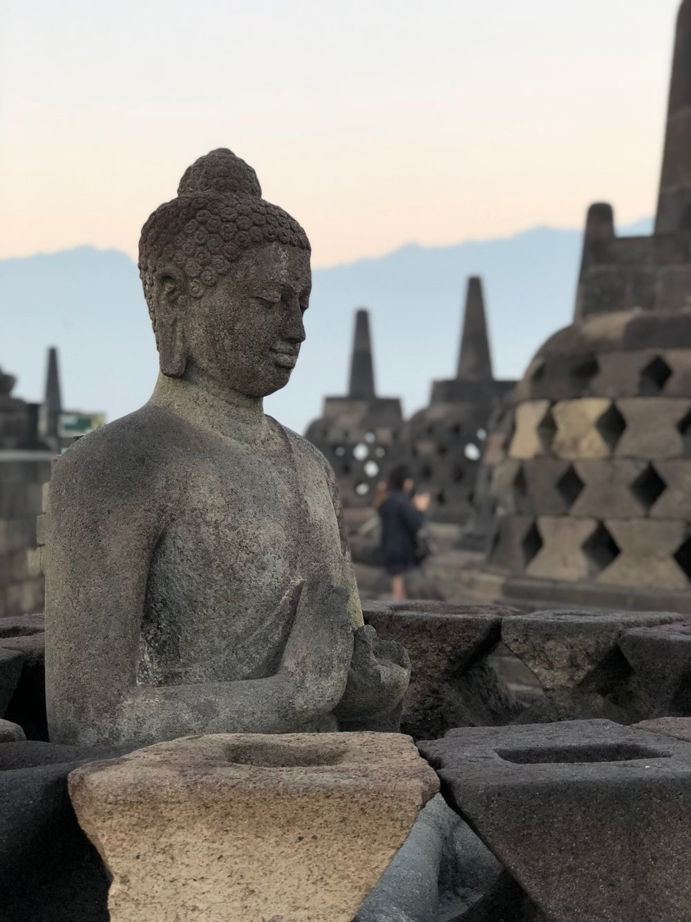 Only two of the 72 Buddha statues are uncovered on the temple's upper terrace