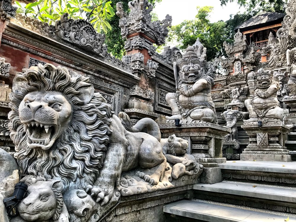 Ferocious beasts populate the entrance to the temple
