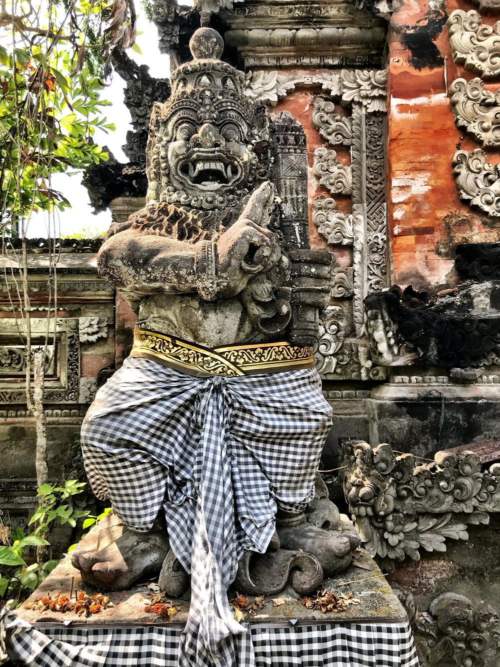 Many temple statues get adorned in sarongs