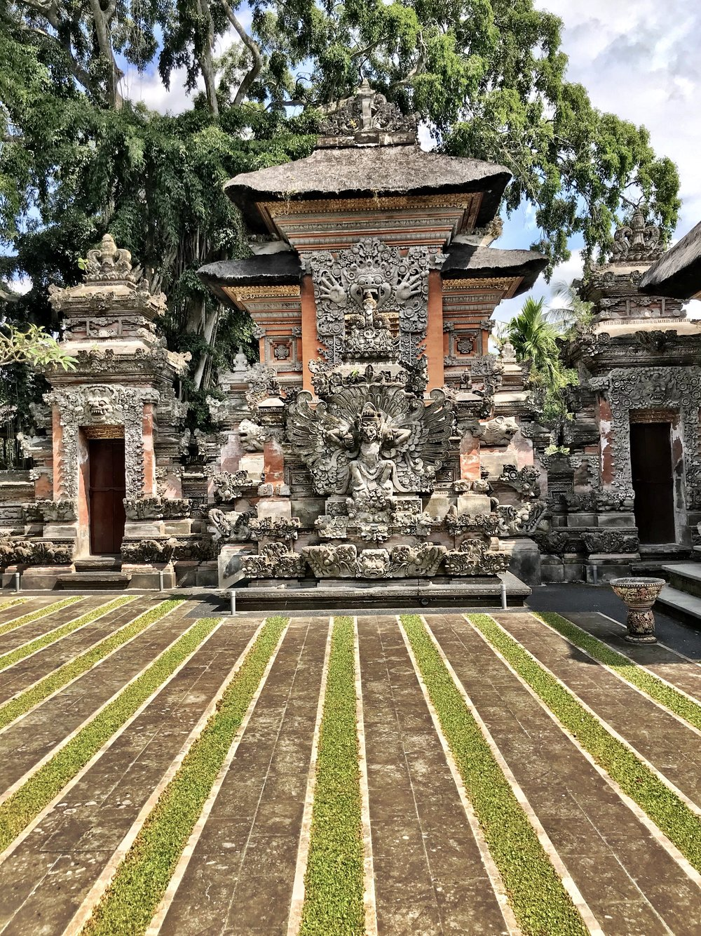 Like many temples in Bali, the interior courtyard features rows of grass and stone