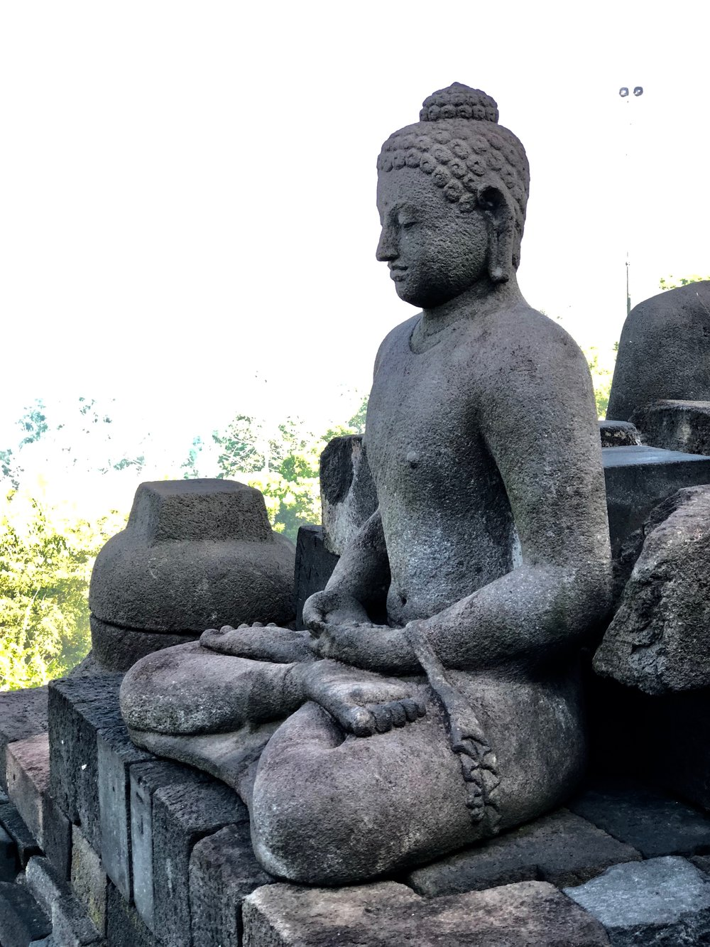 Be sure to check out the carvings as you explore the multi-story Borobudur Temple in Java, Indonesia