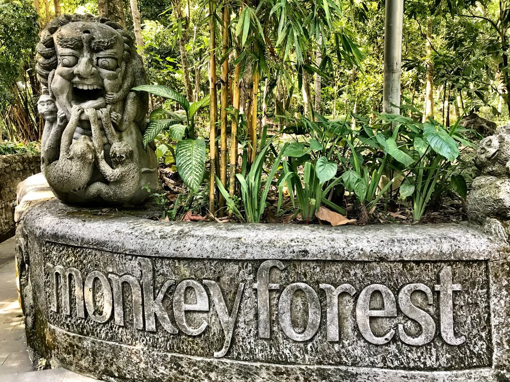 The statue by the Monkey Forest entrance hints at what could happen to unsuspecting tourists!