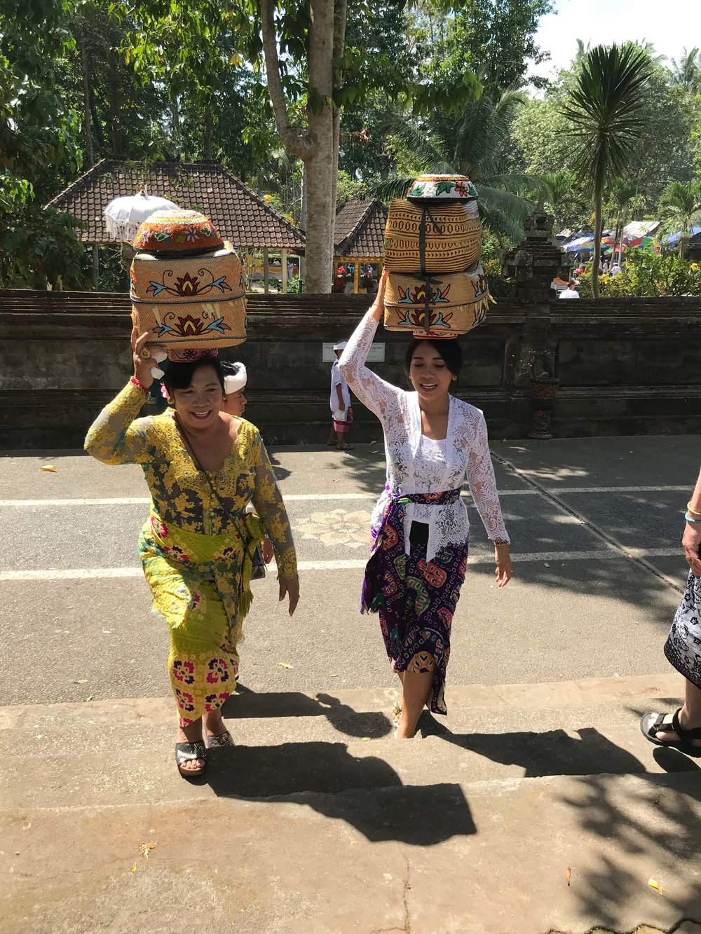 Women carry their loads in woven containers atop their heads