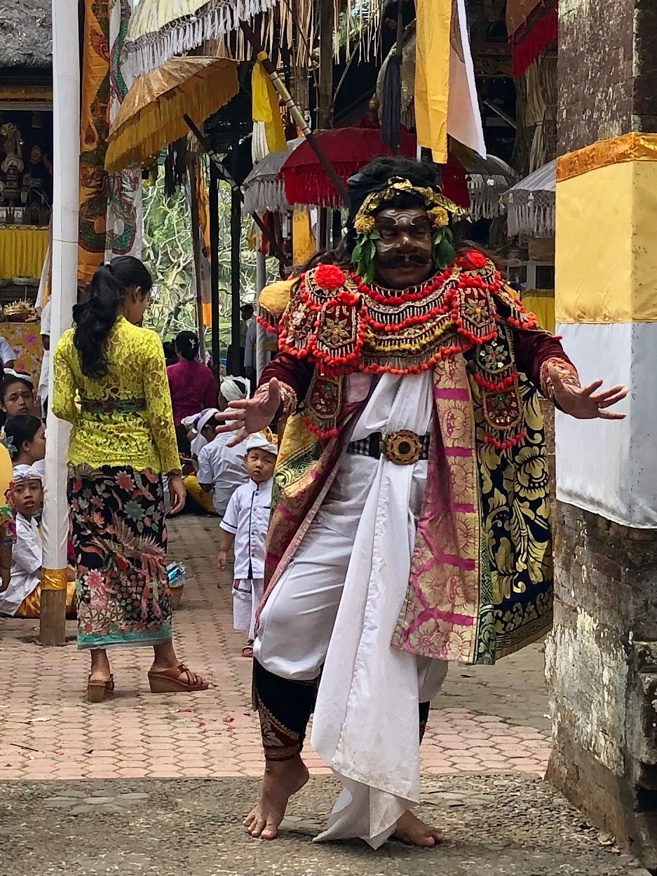 A creepy costumed character danced to the gamelan music
