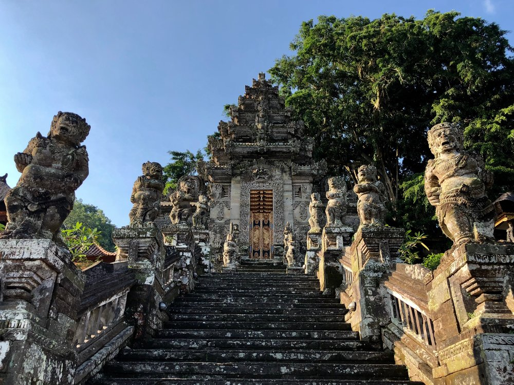 The main staircase of Pura Kehen features frightening guardian statues from the Hindu epic, the  Ramayana