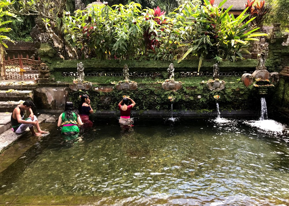 Balinese people bathe in the holy fountains at water temples, like Pura Gunung Kawi in the village of Sebatu